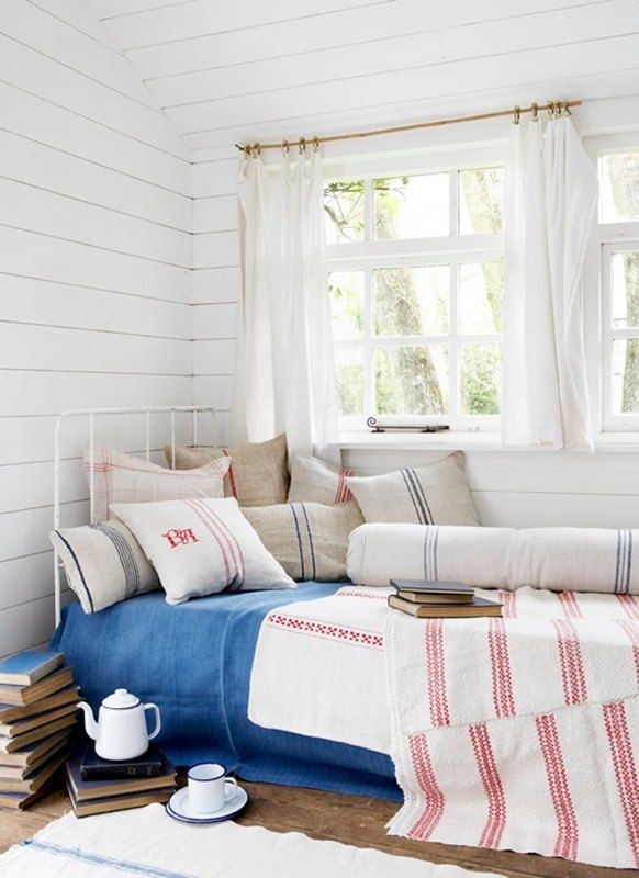 Red, blue stripe bed linens, farmhouse style