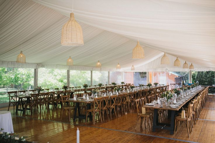 10m marquee structure, silk lining, rattan lampshade, integrated timber flooring, vintage tables, clear walls, south coast weddings, south coast party hire