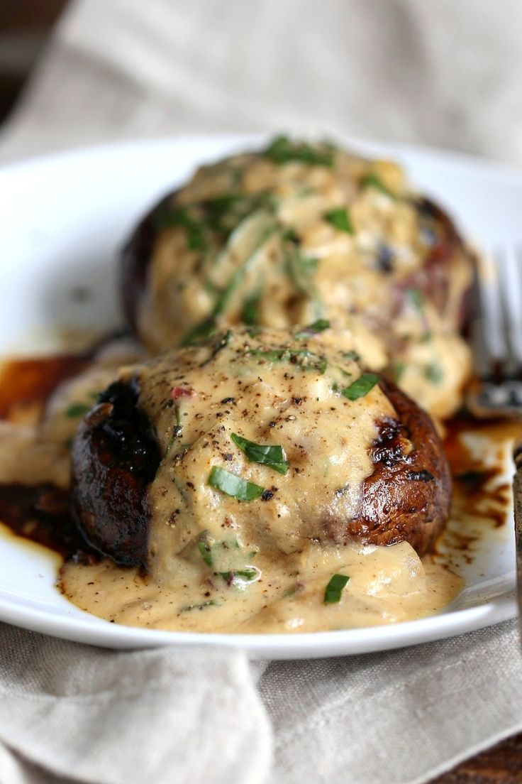 Grilled Portobello Mushrooms with Garlic Sauce. Grilled or Baked Marinated Portabella Mushrooms served with creamy gravy