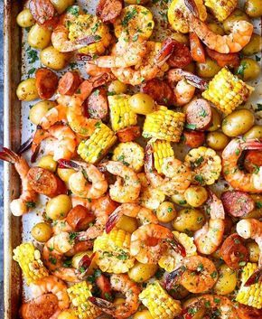 """""""SHEET PAN SHRIMP BOIL ~ 1 pound baby Dutch yellow potatoes 3 ears corn, each cut crosswise into 6 pieces 1/4 cup unsalted butter, melted 4 cloves garlic, minced 1 tablespoon Old Bay Seasoning 1 pound medium shrimp, peeled and deveined 1 (12.8-ounce) package smoked andouille sausage, thinly sliced 1 lemon, cut into wedges 2 tablespoons chopped fresh parsley leaves DIRECTIONS: Preheat oven to 400 degrees F. Lightly oil a baking sheet or coat with nonstick spray. In a large pot of boiling…"""