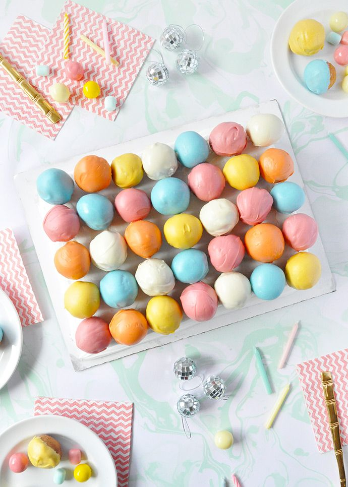Give a grocery store sheet cake a makeover with these colorful donut holes!!