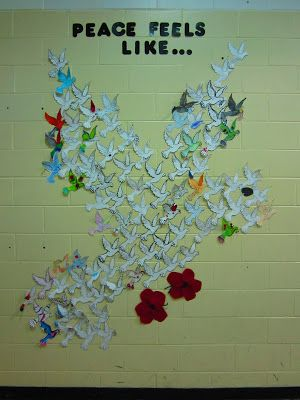 Bulletin board constructed of paper doves with students' written responses of 9/11 and/or world peace