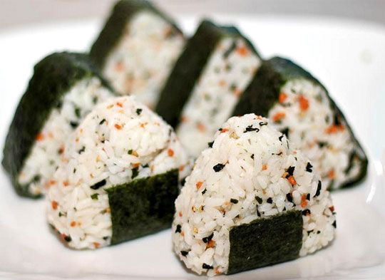 Japanese rice balls as a portable snack or meal. I've got a bag of sushi rice to use...looks like I know what's for lunch!