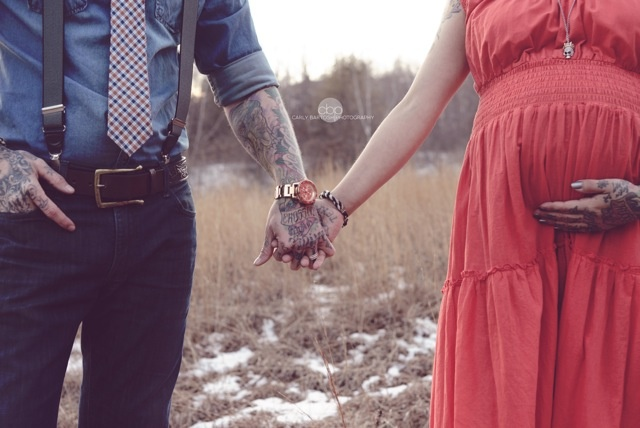 Maternity photo by Carly Bartosh, her work is amazing. Pregnancy pictures at almost 8 months. Love how she captured our tattoos. It was a tad cold but well worth it! Snow still on the ground :) Baby bump holding hands