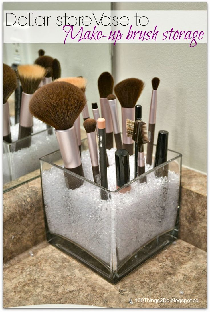 Turn a vase into a holder for makeup brushes. Cheap and pretty!