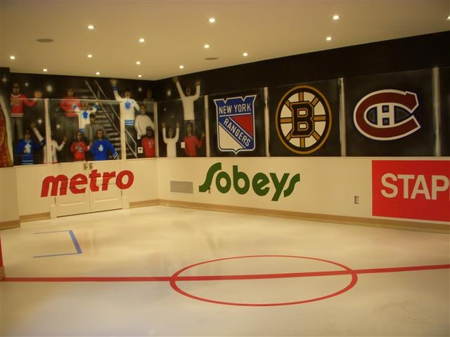 one of the most ridiculously cool hockey rooms ever.