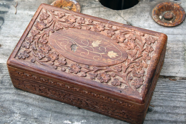 Carved wooden box with inlaid brass