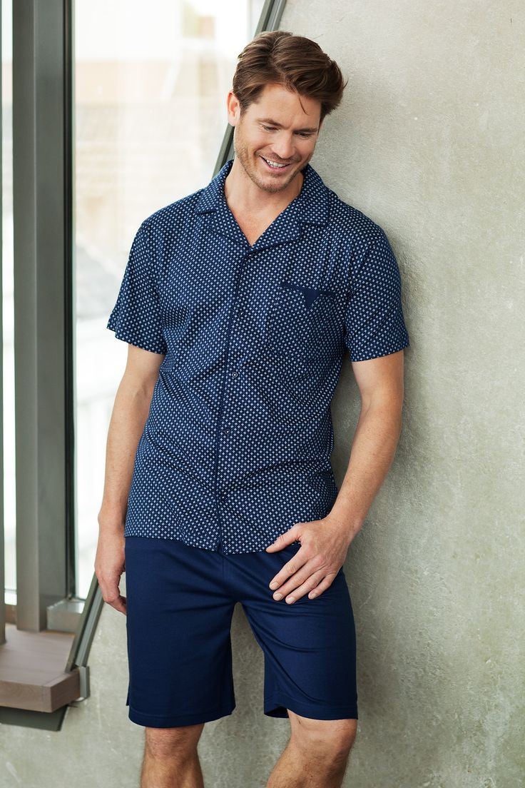 Spend your spare time relaxing in style in this men's navy blue, 'dots & crosses' full button cotton shorty set.