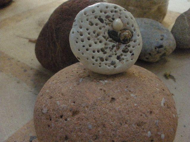 Anna Chronaki, polymeric clay ring, mixed with sand.
