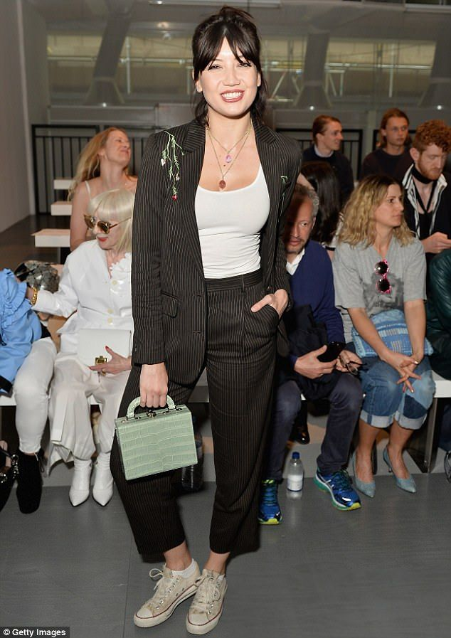 Daisy Lowe power dresses in pinstriped suit at fashion show #dailymail