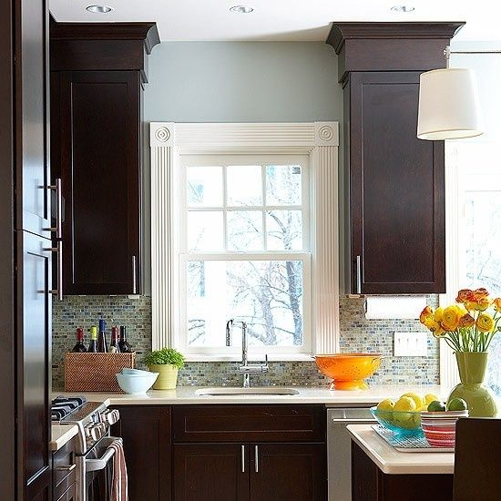 Dark kitchen cabinets with blue walls and backsplash by for Dark walls in kitchen