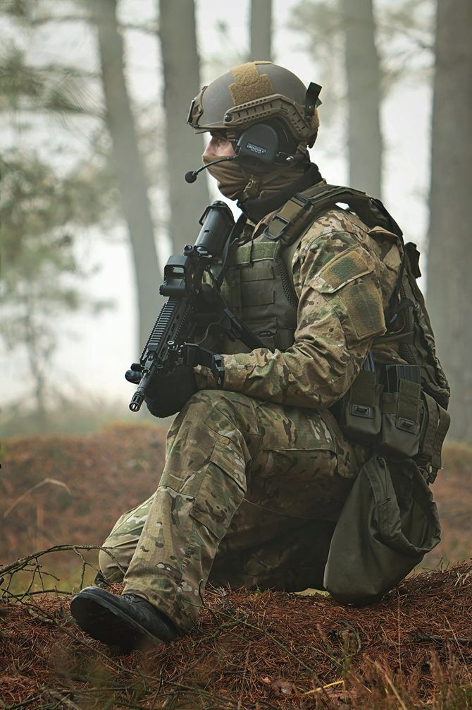 A Polish AGAT Special Forces soldier pauses during an intense period of training. [670 x 1006]