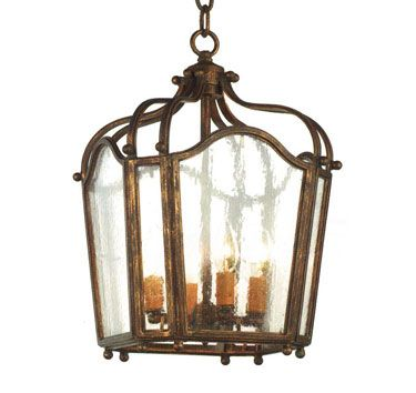 10180 four light iron chandelier finish shown patina gold shown with antique seedy glass