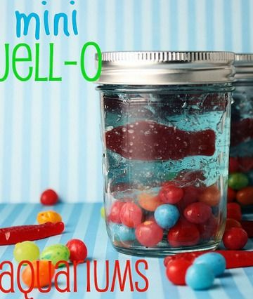 "Mini Jello Aquariums - These Jell-O and candy filled treats are so fun for parties!!  Little ones love to see the candy fish ""swimming"" in the bowl.  Inexpensive, simple, and impressive!!"