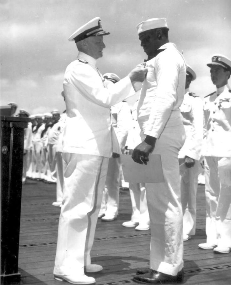 Black sailor's Pearl Harbor heroics helped end racism in military Doris Miller receives the Navy Cross on May 27, 1942.