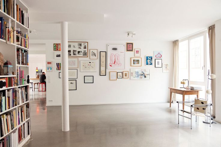 Bookcase, random picture collection, polished concrete floor, white walls....predictable........but still, what's not to love!