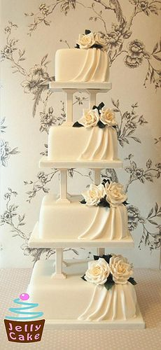 Ivory Roses and Drapes Wedding Cake