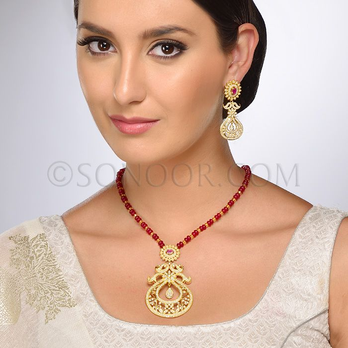PEN/1/3707 Ajali Pendant Set with Earrings in dull gold finish studded with cubic zircons and jade stones