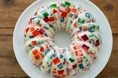 Broken Glass Jello Bundt -   note: Only add 1 cup of water to each box of colored Jello.so tat it's firm and can be cut into blocks. Ignore the instructions on the box (they say to use 2 cups of water).  Increase packets of gelatin from two to three envelopes. Lightly oil the Bundt pan with canola oil and then wipe out 99% of it. After the bundt is refrigerated overnight, unmold by dipping the pan very briefly in warm water then invert onto a serving platter.