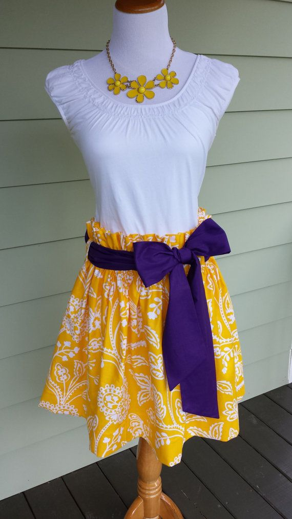 """Women's boutique gameday skirt """"The Derby Skirt"""" in yellow garden party with a purple sash, LSU tigers custom made by Collyn Raye"""