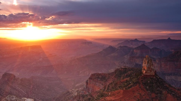 Sun peeking over the skyline of the Grand Canyon!