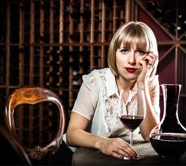 Rebecca Gibb with decanter and glass of wine on RebeccaGibb.com