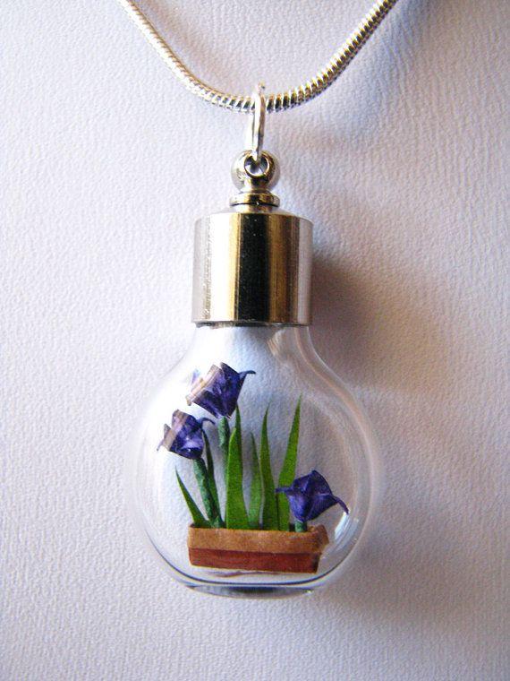 Tiny origami irises in a necklace. So pretty.