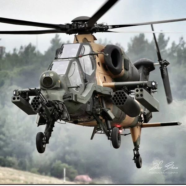"""Foto: Turkish new, TAI """"T-129 ATAK"""" Combat Helicopter, ● 100 units will be produced. now 14 T-129 active ● Maksimum Speed : 278 km ● Maximum altitude : 6096 m ● Engine : 2 x1362 shp ● Weapon Systems : 1x 20 mm Heavy Machine gun, 1x8 """"L-UMTAS"""" Anti-Tank missile, 1x12 Laser guided """"CİRİT"""" Missile, 2x Stinger, 1x 32 Rocket"""