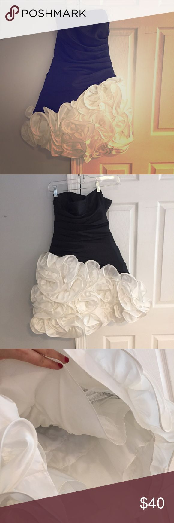 Black-and-white party dress Black-and-white straplessparty dress bottom has the swirly ruffle. Underneath does have crinoline but has a lining so it's not itchy on the legs. Great for prom or other special occasion. Dresses Strapless