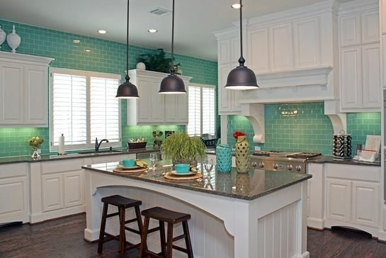 Aqua backsplash with white cabinets