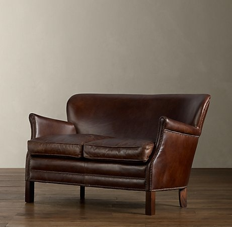 I am constantly scheming about how to someday own a leather chair. How about this...it's like having two leather chairs. This is just beautiful...like something out of a 1920's men's club. Want.