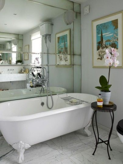 Antique Mirrored Bathroom wall! LOVE! Designer-Jenny-Packhams-Hampstead-home