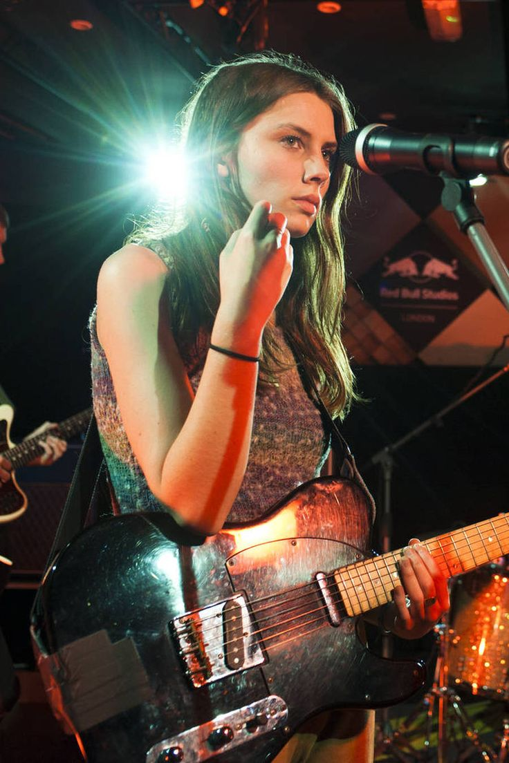 Anime rock girl with guitar