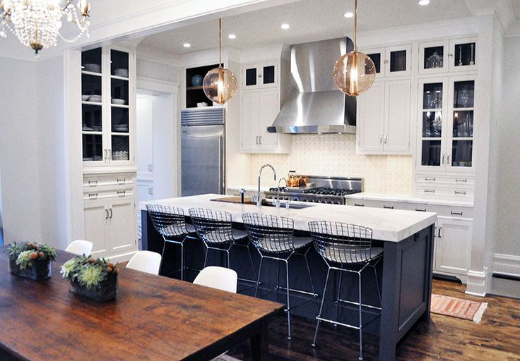 Using an assortment of lighting fixtures and styles will define the kitchen and dining areas as different zones, though they may only be separated by mere feet. Switch up the styles of your sconces, pendants, and chandelier to keep the design cohesive, but dimensional.