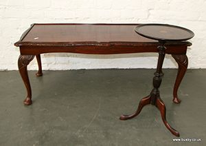 A mahogany Edwardian dish top wine table with fan paterae, together with a modern rectangular coffee table