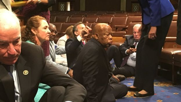 Democrat members of Congress, including Democratic Rep John Lewis, (centre) in sit-down protest seeking a a vote on gun control measures, Wednesday, 22 June 2016