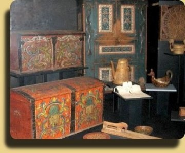 Chest and cupboards painted in traditional rose paint from The Norwegian Folk Museum