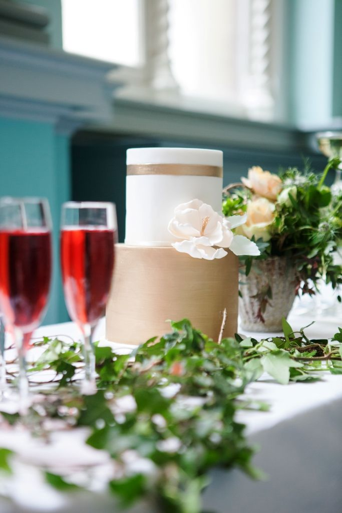 Champagne flutes, wedding cake with flower and ivy decoration at Royal College of Physicians Dublin