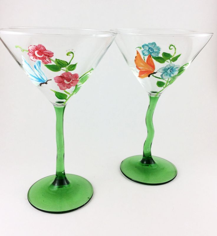 Hand painted Martini glasses with beautiful flowers and butterflies. Each Glass is hand painted and may have slight variations making them unique. These are a set of 2 - 12 0z. Martini glasses.  I love these glasses! There are so many different ways you can use Martini glasses.  This set of hand painted glasses is perfect for so many things. ** Dessert glass for ice cream  ** Dinner table center piece with a votive candle. ** Birthday, weddings and anniversary gifts ** Addition for your…