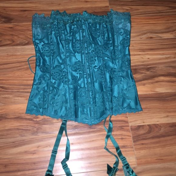Teal blue corset Beautiful teal blue corset with garder. I hook all the way up the front and lace up back Frederick's of Hollywood Intimates & Sleepwear Shapewear