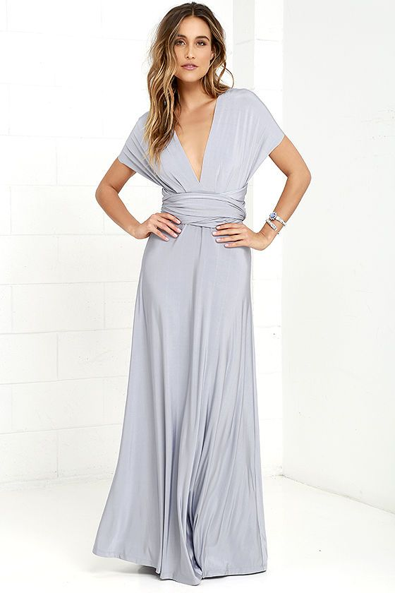 "Any which way you wrap it, the Always Stunning Convertible Light Grey Maxi Dress is one amazing dress! Two, 82"" long lengths of fabric sprout from an elastic waistband and wrap into dozens of possible bodice styles including halter, one-shoulder, cross-front, strapless, and more. Stretchy light grey fabric has a satiny sheen, and a full length maxi skirt pairs perfectly with any choice you make up top. Want Styling Tips? <a href='http://bit.ly/HowToWearIt' target='_blank'>See How To Wear…"