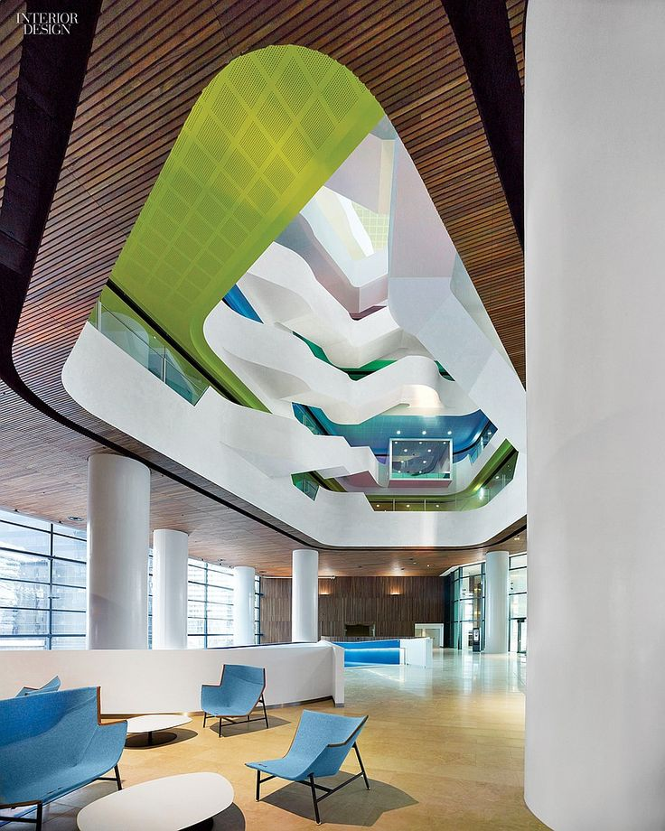 A Working Work of Art: Hassell Transforms Office Life for Melbourne's Medibank | Doshi Levien chairs join Patricia Urquiola tables in the main reception area.