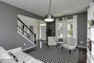 Contemporary Living Room with Safavieh Radium Stool, White Tufted Accent Chair, Hardwood floors, Alexa Chevron Vibe Zebra Rug