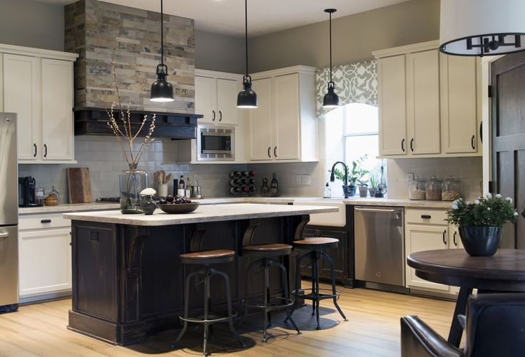 Interior design -ed by Carla Aston, interior designer / Photography by Tori Aston | Home kitchen renovation-remodel-makeover; rustic style; builder production home; tile floor; cabinet; island; barstool; hood; countertop; appliance; backsplash; bungalow; hood; coffee house; lighting; custom-made.