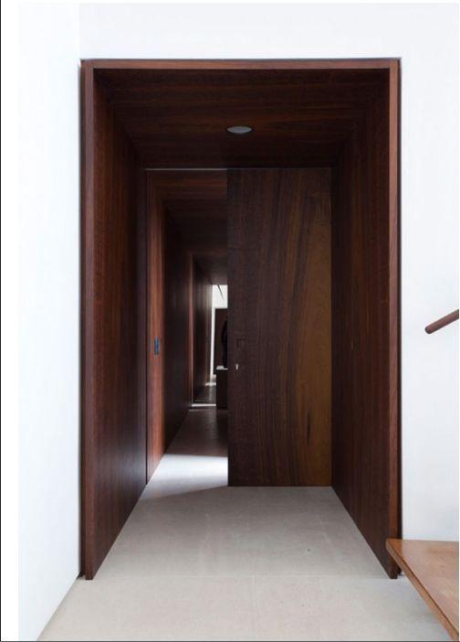 Wooden door frame and corridor