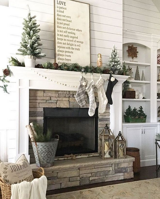 Beautiful farmhouse fireplace. Love all the shiplap.