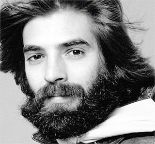 Kenny Loggins (I use to have the biggest  crush on him when I was younger, wait WTF am I talking about, I still!) LOL :D