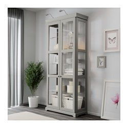 IKEA - LIATORP, Glass-door cabinet, gray, , 3 adjustable glass shelves.  Adjust spacing according to your storage needs.2 stationary shelves for greater stability.Adjustable feet provides stability on uneven floors.Tempered glass doors keep your favorites free from dust, but still in full view.Hinges with integrated dampers ensure the doors close slowly, silently and softly.