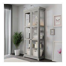 IKEA - LIATORP, Vitrinskåp, grå, , 3 flyttbara glashyllplan; anpassa avstånd efter ditt förvaringsbehov.2 fasta hyllplan; för ökad stabilitet.Justerbara fötter; står stadigt även på ojämna ytor.Dörrar av härdat glas håller dina favoriter dammfria men synliga.Gångjärn med inbyggd dämpare fångar upp dörrarna i farten så att de stängs långsamt, tyst och mjukt.