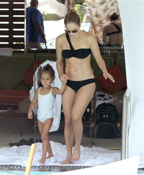 Look at those abs! They're incredible. All summer long we've enjoyed checking out J.Lo's bikini body, but this pic proves that this hot mama still knows how to werk it. See more celebs on Wonderwall. http://on-msn.com/Om5y5pJlo